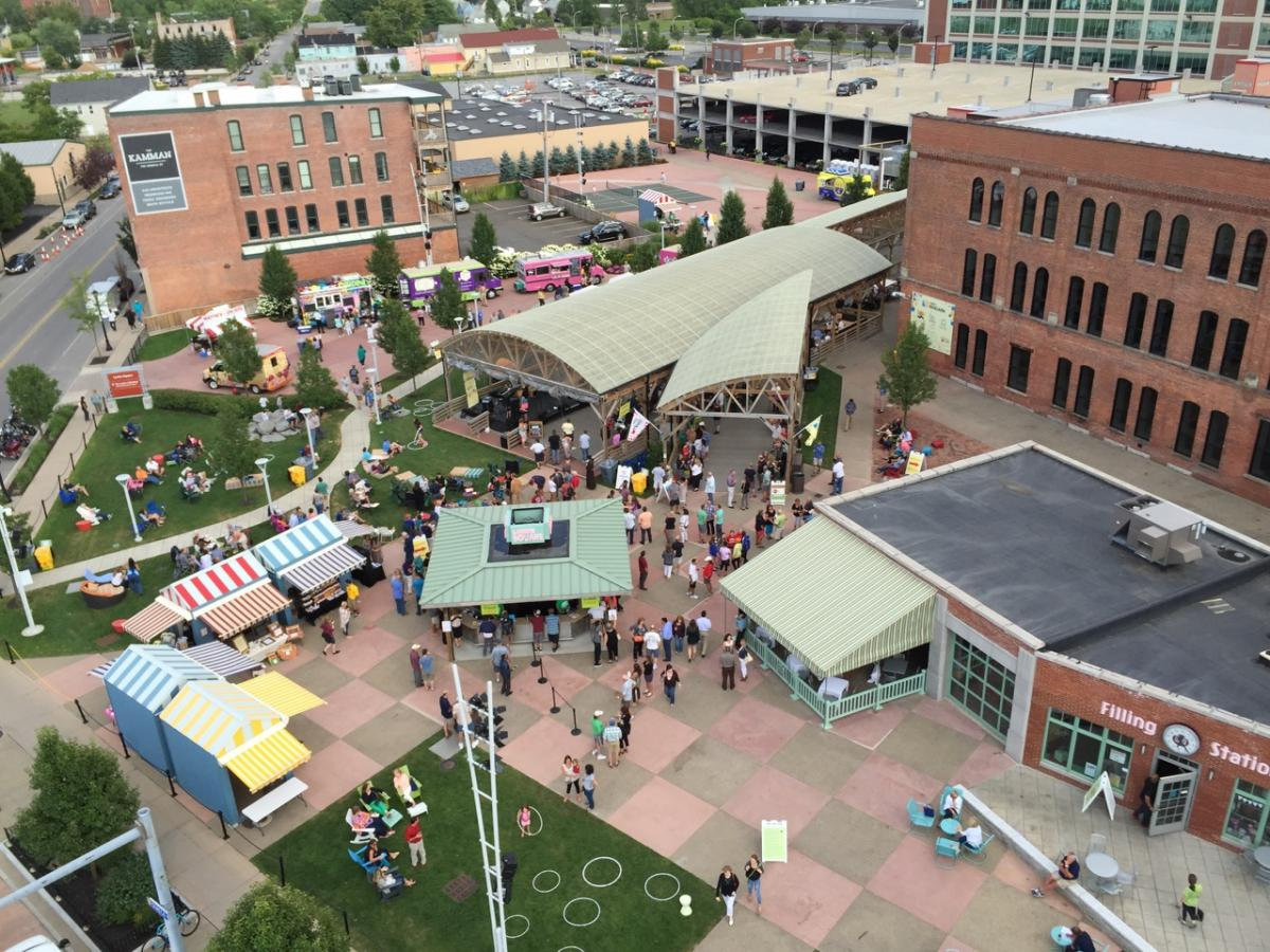 An aerial of Larkin Square shows public spaces, the performance pavilion, food stands, and other areas of activity.