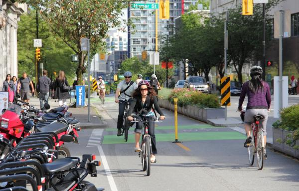 separated bike facilities in Dunsmuir, Vancouver, BC. By Paul Krueger, Flickr