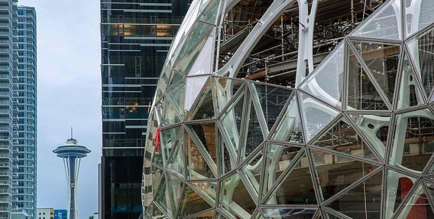 The distinct sphere at the Amazon headquarters building in Seattle, with the Space Needle in the distance